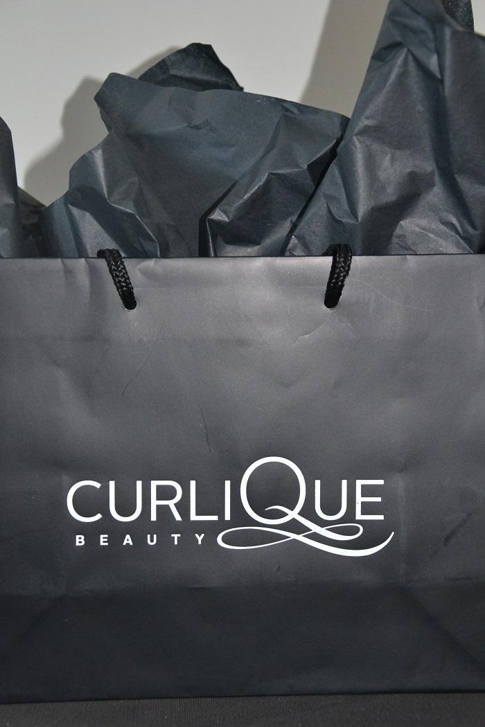 curlique bag with face lace