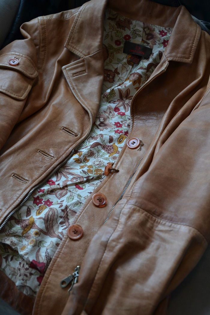 brown moto jacket with a floral lining