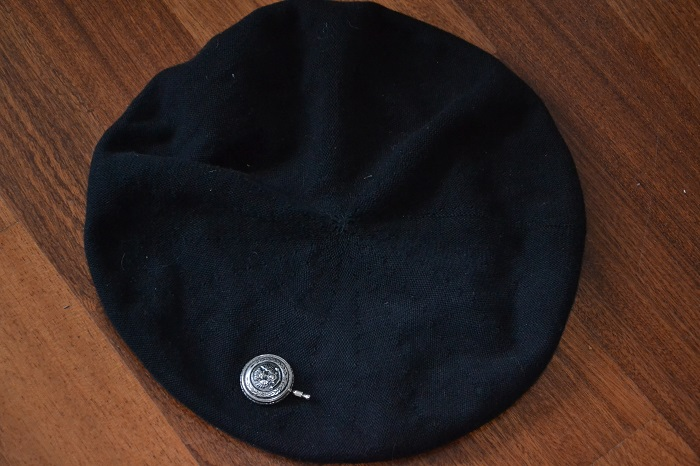 black beret with anique hat pin