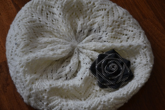 White beret with black flower