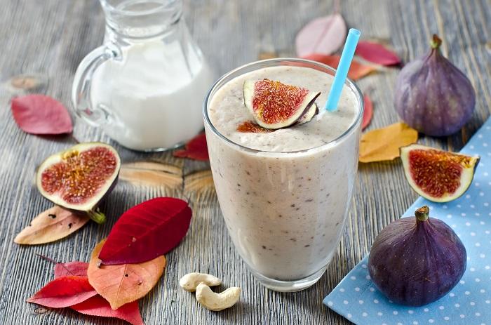 Healthy beverage in autumn wooden background